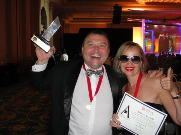 COO Vladimir Suchevan and VP of Sales Svetlana Kostromitina receivibg award in Las Vegas.
